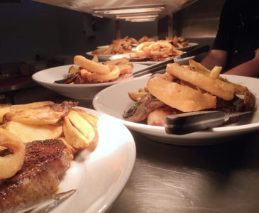 Steaks on the pass, ready to go out.